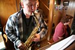 Christian Boyd plays the saxophone, accompanied by music teacher Debby Peckham in Burns, Ore., on April 14, 2019.
