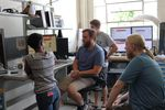 OSU robotics students (left to right) Elizabeth Childs, Kevin Green, Taylor Apgar and Andrew Sanders gather around a computer to research the spring-mass model theory.