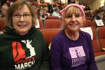 """Rynda Clark and Mary Fleischmann had to ditch signs reading """"Support Public Lands,"""" before they could get in to the town hall."""
