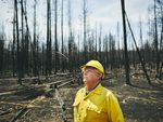 Don Gentry, Klamath Tribes chairman, looks at the charred remains of Klamath ancestral lands burned in the Bootleg Fire.