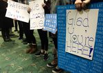 Signs welcomed refugees to Oregon during the fight over President Trump's travel ban earlier this year.