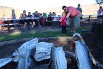 Visitors to Kah-Nee-Tah watch salmon being cooked over an open flame for the resort's final weekend dinner.