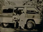 """Rodney and Jen with Mitsubishi Delica"" by Elizabeth Fennelly"