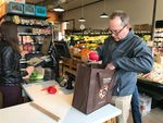 An unidentified customer at Northeast Portland's Alberta Co-op Grocery who packed his own reusable bag.