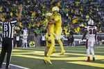 Oregon tight end Terrance Ferguson (19), left, celebrates his touchdown with Oregon tight end Moliki Matavao (8) during the third quarter of an NCAA college football game against Stony Brook Saturday, Sept. 18, 2021, in Eugene, Ore.