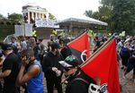In this Saturday, Aug. 11, 2018 file photo, a group of anti-fascist and Black Lives Matter demonstrators march in front of the Rotunda on the campus of the University of Virginia in anticipation of the anniversary of the previous year's Unite the Right rally in Charlottesville, Va.