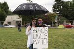 Elizabeth Renguso and her 17-year-old daughter, Sophia, hold a sign during a protest at Revolution Hall, in Portland, Ore.