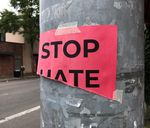 """A torn """"Stop Hate"""" sign that was previously hung up in downtown Eugene (file photo)."""