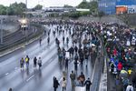 Protesters marching against racist violence and police brutality block traffic on Highway 84 in NE Portland on June 8, 2020.