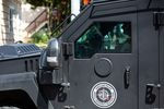 The Portland Police Bureau's Specialty Emergency Reaction Team, or SERT, responds to a person believed to be armed barricaded inside a home in the Sellwood neighborhood of Portland, Ore., Sunday, June 28, 2020.