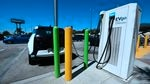 A vehicle is plugged in to an electric car charging station.