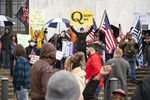 A follower of the fringe conspiracy theory group QAnon stands in front of the Oregon state Capitol during a rally to reopen Oregon in Salem on Saturday, May 2, 2020.