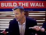 Former Kansas Secretary of State Kris Kobach talks to the media after announcing his Senate candidacy on July 8, 2019.