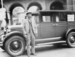 Lung On with sedan, 1927. Lung On opened the first car dealership in Oregon. He was the first Chinese in the country to do so.