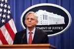 Attorney General Merrick Garland speaks at the Justice Department in August.