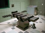 "FILE - This March 22, 1995, file photo shows the interior of the execution chamber in the U.S. Penitentiary in Terre Haute, Ind. Executioners who put 13 inmates to death in the last months of the Trump administration likened the process of dying by lethal injection to falling asleep, called gurneys ""beds"" and final breaths ""snores."" But those tranquil accounts are at odds with AP and other media-witness reports of how prisoners' stomachs rolled, shook and shuddered as the pentobarbital took effect inside the U.S. penitentiary death chamber in Terre Haute, Indiana"