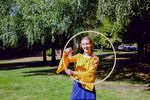Paisley Armstrong dances with her hula hoop near Mount Tabor Park in Portland.