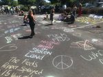 The scene at a Bend parking lot the day after protesters delayed ICE arrests by creating a human roadblock, Aug. 13, 2020.