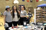 Angel TwoBulls, left, Leah Altman, center, and Chenoa Landry, right, at the Native American Youth and Family Center's Spring Marketplace.
