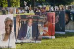 In this Aug. 31, 2020, file photo, some of the nearly 900 large poster-sized photos of Detroit victims of COVID-19 are displayed on Belle Isle in Detroit.